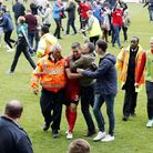 Michael Clark is kissed by a Leyton Orient fan as he leaves the pitch following the 2-1 win over Har