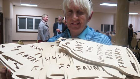 East End Preservation Society's Jill Wilson handing out wood cut-outs in campaign to save bell found
