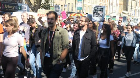 Climate change protesters march along Whitechapel Road for the third of three rallies along the A11.