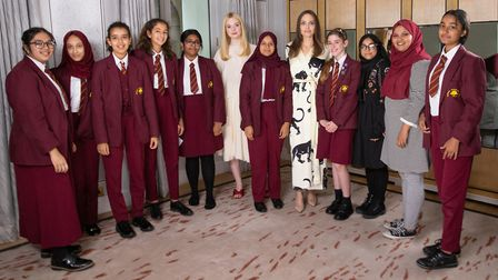 Angelina Jolie and Elle Fanning meeting pupils from Mulberry School for Girls in Whitechapel. Pictur