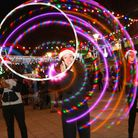 Round in circles... circus performers are always a hit at Chrisp Street's Christmas festivals. Pictu