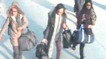 The three girls as they made their way through Gatwick airport, from left to right: Amira Abase, 15,