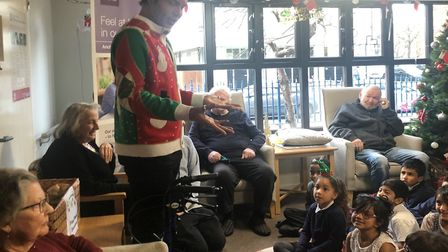 TV's Bobby Norris meets Bethnal Green schoolchildren visiting Silk Court care home. Picture: Anchor