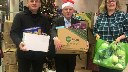 Tower Hamlets mayor hands over 1,000 gifts to volunteers at Bow food bank. Picture: LBTH