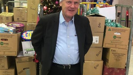 Major John Biggs with the 1,000 girfts of food and toys donated by his council staff. Picture: LBTH
