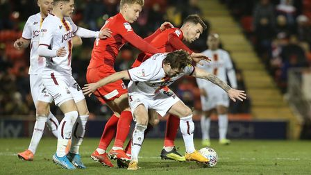 Orient's Josh Wright and Craig Clay tackle Bradford's Jake Reeves (pic Simon O'Connor)