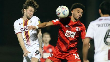 Orient's Lee Angol battles with Bradford rival Jake Reeves (pic Simon O'Connor)