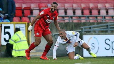 Orient's Jamie Turley battles with Bradford's James Vaughan (pic Simon O'Connor)