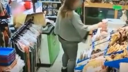 This is the moment a woman takes a charity tin from Pets Paradise in Poplar. Picture: Submitted