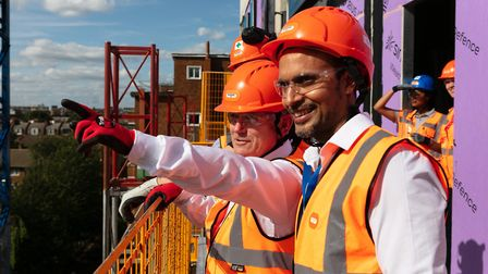 Mayor John Biggs pointing to East End's mass housebuilding from balcony of Stepney flats under const