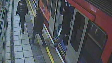 Police would like to identify the men centre and right. Picture: Met Police