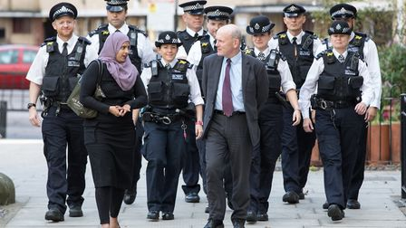 Mayor John Biggs and Deputy Mayor Cllr Asma Begum with police officers in Tower Hamlets. Picture: Ko
