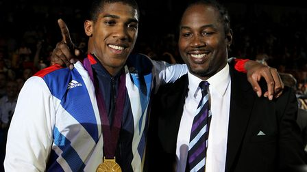 Great Britain's Anthony Joshua poses with former gold medalist Lennox Lewis following his super-heav