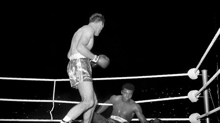 Henry Cooper knocks down Cassius Clay during the fourth round of their 1963 contest at Wembley Stadi