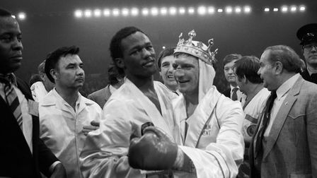 Welshman Colin Jones, centre right, smiling in defeat after WBA world welterweight champion Don Curr
