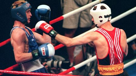 Great Britain's David Burke (left) reels backwards from a punch from Germany's Falk Huste during the