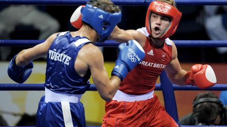 Great Britain's Billy Joe Saunders (red) in action against Turkey's Adem Kilicci during their welter