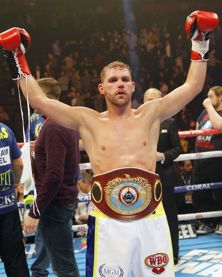 Billy Joe Saunders celebrates winning the WBO world middleweight title at Manchester Arena
