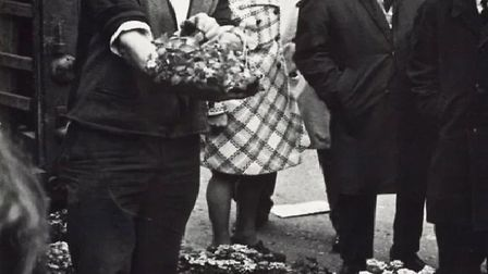 George in his heyday in the 1960s selling plants from the back of his van. Picture: Gladwell family