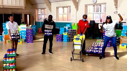 Volunteers stocking up at this east London foodbank... but keeping their 'social distance' from each