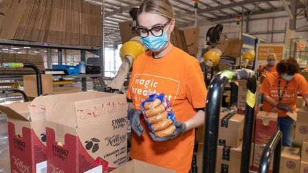 Staff packing children's healthy breakfasts at Amazon's Bromley-by-Bow depot for home delivery durin