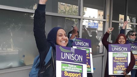 Striking defiance... outside Tower Hamlets council's housing office in Bethnal Green. Picture: Uniso