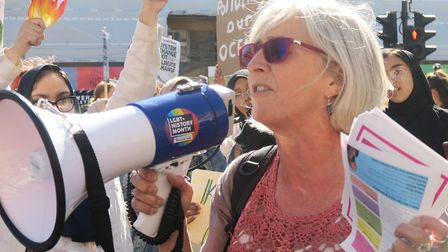GP Jackie Applebee swaps her claronet to 'play' the megaphone at a 'climate emergency' demo in White