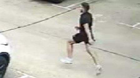 Snapshot of bearded man seen running through car park... but where's the bike? Picture: Met Police