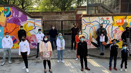 Splashing out... members of Wapping Youth FC sprucing up the dull streets with colourful tribute mur