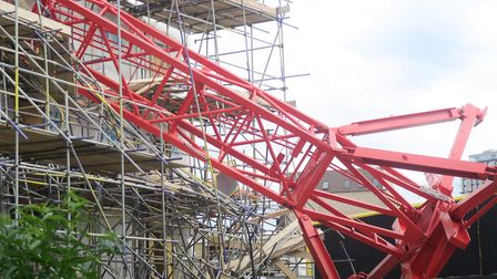 60ft crane that came to rest on Bromley-by-Bow new block of flats being built at Watts Grove. Pictur