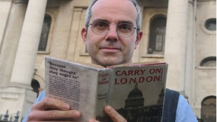Gideon Calder at Spitalfields with his uncle Richard Calder's wartime book, Carry on London. Picture