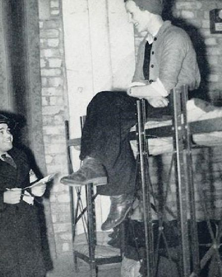 Mickey Davis known as 'the midget with a big heart' running wartime air-raid shelter at Spitalfields