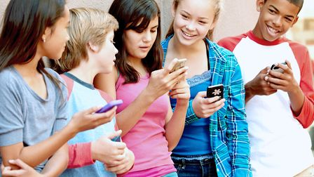 Youngsters get to grips with app going online with its artificial intelligence. Picture: SafeToNet