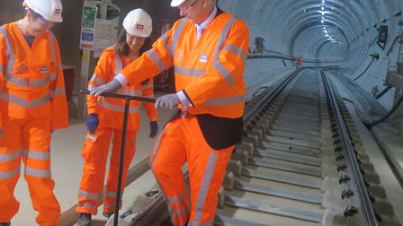 Transport minister Chris Grailing fixing last bolt at Whitechapel as Crossrail tracks are completed
