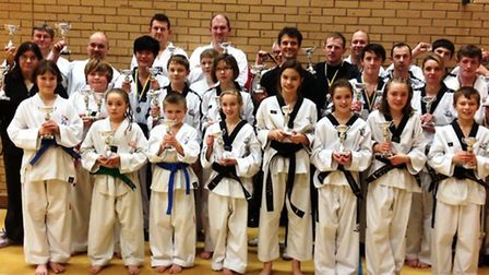Stars from the Mark Farnham School of Tae Kwon-Do show off their silverware.