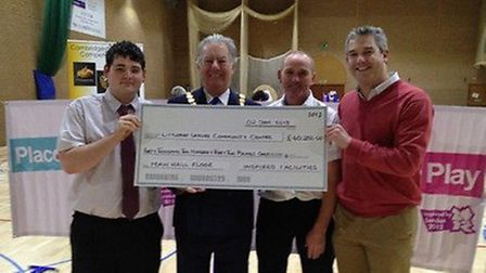 Tony Parramint, second left, Andy Rutterford and MP Steve Barclay recieved a cheque for £40,000 from