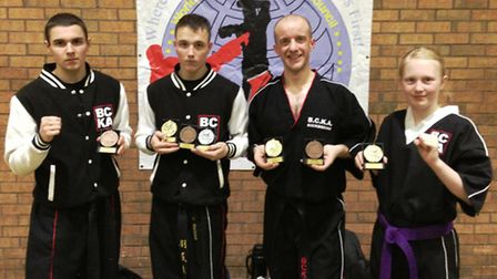 From left, Grant Brown, Courtney Brown, Aaron Godden and Freya Molloy show off their silverware.