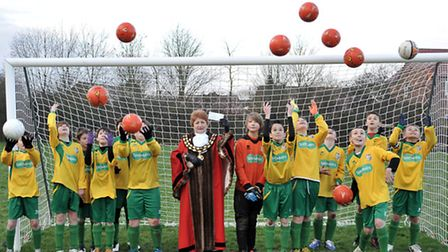 Cheque presentation from March town council to Estover under 12s football team for new goal posts.