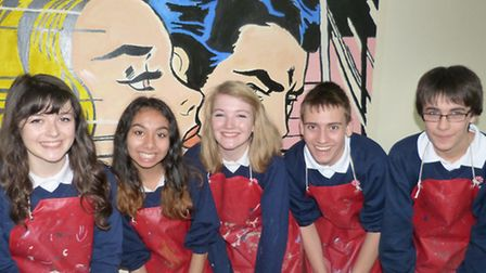 Ely College students working on a pop art mural