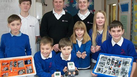 Pupils from the Park Lane Primary School in Whittlesey work with experts from Enriched IT in compute