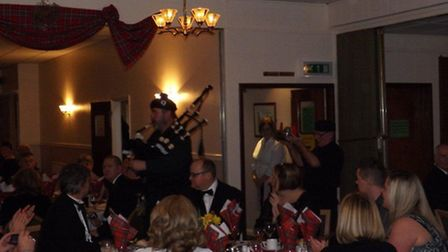 Diners enjoy the sound of bagpipes and feast upon haggis at March Conservative Club's Burns night