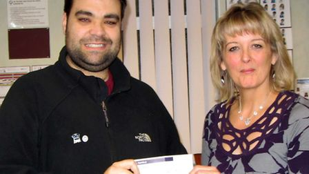 Chris Brudenell presents a cheque to Margaret Leverett