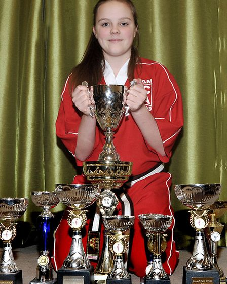 Charlotte Cameron shows off her silverware.