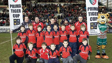 Wisbech Rugby Club Under-10s face the camera on the pitch at Welford Road.