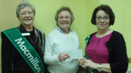 Marion Edwards, chairman, March Homemakers made the presentation to Gill Smith, (right) chairman, an