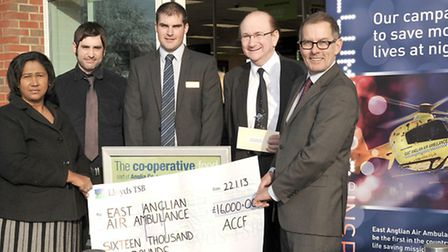 Cheque presentation of £16,000 to the East Anglian Air Ambulance at the Anglia Co-op food store, Lit