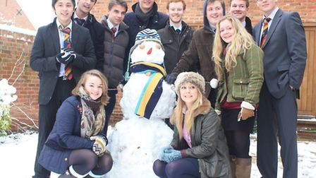 Wisbech Grammar School sixth form students pose with their snowman