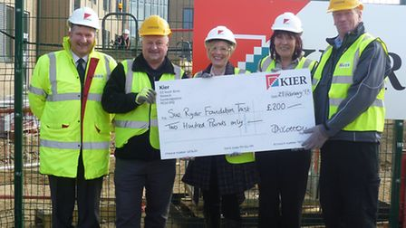 Alison Toomey accepts the cheque from Kier Construction