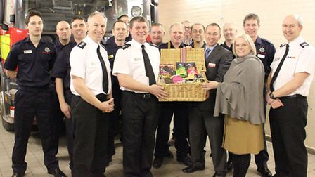 Charity bosses present the hamper to the crew at Chatteris Fire Station.