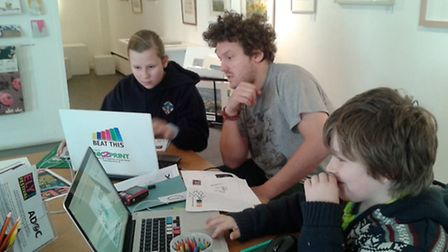 Young designers try their hand at creating a new logo, helped by designer Benny Turner from Beat Thi